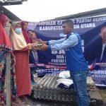 DPC Partai Demokrat Butur, Salurkan 100 Paket Sembako